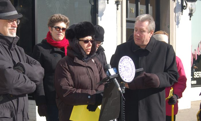 Council member Daniel Dromm (R) and Jackson Heights residents stand outside Starbucks on 79th Street, Manhattan, New York, Feb. 28, 2014. (Courtesy of Council member Daniel Dromm)
