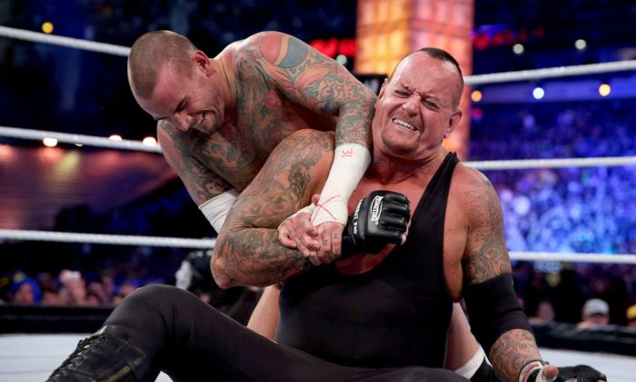 The Undertaker and CM Punk in a 2013 file photo. (WWE)