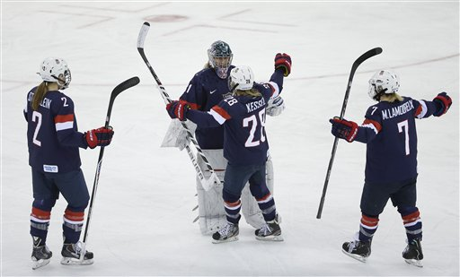 USA Goalkeeper Jessie Vetter and Amanda Kessel meet near mid ice with Lee Stecklein and Monique Lamoureux after defeating Sweden 6-1 during a 2014 Winter Olympics women's semifinal ice hockey game at Shayba Arena, Monday, Feb. 17, 2014, in Sochi, Russia. (AP Photo/Matt Slocum)