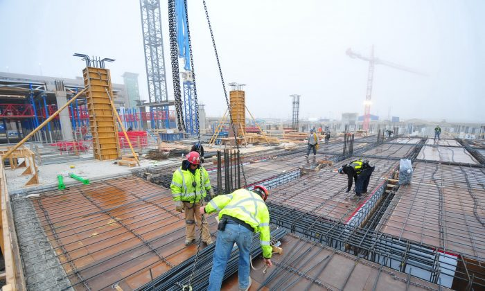 Construction workers build the new concourse for the Calgary International airport, to be finished by October 2015. Current restrictions on the number of apprentices a company can have in relation to the number of journeypersons is making it harder for Aboriginals to pursue trade careers. (Courtesy of Calgary Airport Authority)