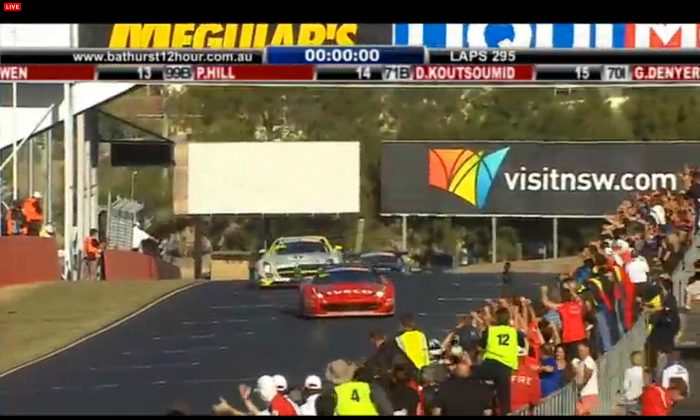 The #88 Maranello Ferrari takes the checkered flag just ahead of the #84 HTP Mercedes at the end of the 2-014 Bathurst 12 Hours from the Mount Panorama circuit in Bathurst, New South Wales, Sunday, Feb 9. (bathurst12hour.com.au)
