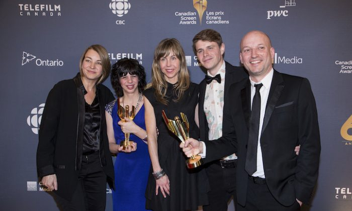 The cast and crew of Gabrielle celebrate the film's Best Picture award. (L-R) Producer Kim McGraw, Best Actress winner Gabrielle Marion-Rivard, director Louise Archambault, and producer Luc Déry. (Evan Ning/Epoch Times)