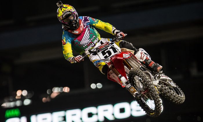 A rider flies into the air at the Monster Energy Supercross at Toronto's Rogers Centre on March 22, 2014. Toronto was the only Canadian stop of the professional racing series. (DQC Photo)