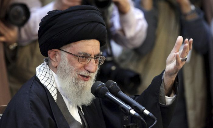 In this picture released by an official website of the office of the Iranian supreme leader, Supreme Leader Ayatollah Ali Khamenei, gives a speech at a public gathering in the city of Mashhad, Iran, Friday, March 21, 2014. (AP Photo/Office of the Iranian Supreme Leader)