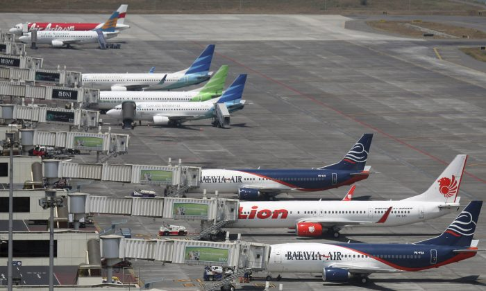 Jets from five different Asian airlines await passengers at Juanda International Airport in Surabaya, East Java, Indonesia. Air travel in Asia is surging as the middle class gets bigger, discount airlines proliferate and business ties with the rest of the world deepen. (AP Photo/Trisnadi, File)