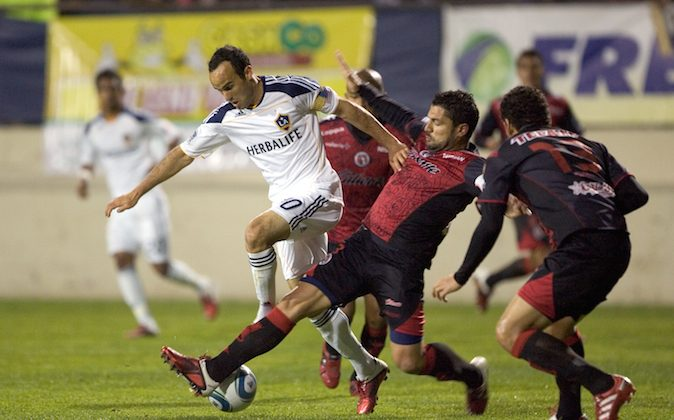 Landon Donovan #10 of the Los Angeles Galaxy is challenged for the ball by Javier Yacuzzi #3 of Club Tijuana during the second half at the exhibition game at Torero Stadium on March 2, 2011 in San Diego, California. (Photo by Kent Horner/Getty Images)