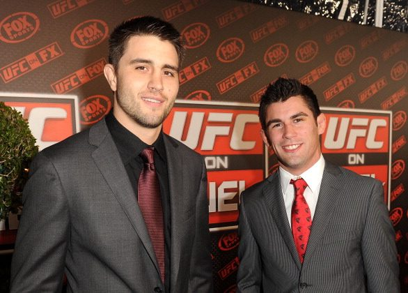 Mixed martial arts fighters Carlos Condit (L) and Dominick Cruz attend UFC on Fox: Live Heavyweight Championship at the Honda Center on November 12, 2011 in Anaheim, California. (Photo by Jason Merritt/Getty Images)