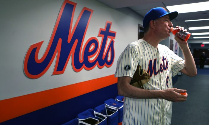 New York Mayor Bill de Blasio takes a break after serving his ceremonial pitch at the opening game in Citi Field, Queens, during the Mets game, on Monday, March 31, 2014. (Rob Bennett for the Office of Mayor Bill de Blasio)