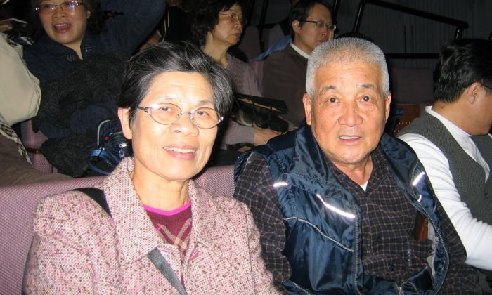 Painter Fan Hongzhi and  his wife watched Shen Yun at the Taoyuan County Performing Arts Center for the first time on March 23, 2014. (Zheng Xinci/Epoch Times)