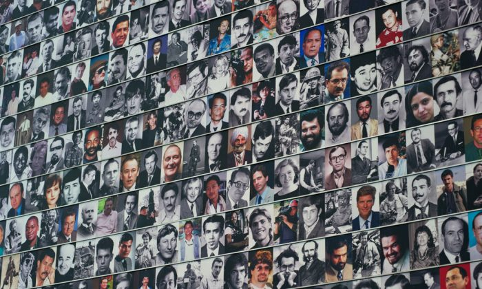 Faces of fallen journalists displayed at the Journalists memorial wall at the Newseum in Washington (Karen Bleier/AFP/GettyImages)