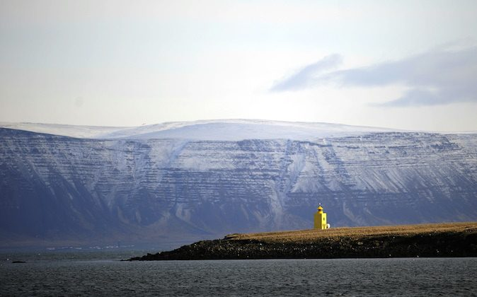 The sun shines on a yellow lighthouse outside Reykjavik harbour early in the morning on April 23, 2009. (OLIVIER MORIN/AFP/Getty Images)