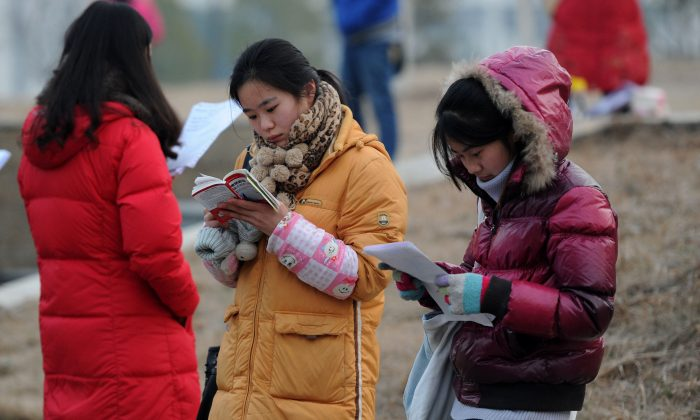 Students go over their notes before taking exams in Hefei on Jan. 5, 2013. Over one hundred female college students from across China jointly raised awareness of sexual assaults against young girls on school campuses during the National People's Congress in March of 2014. (STR/AFP/Getty Images)