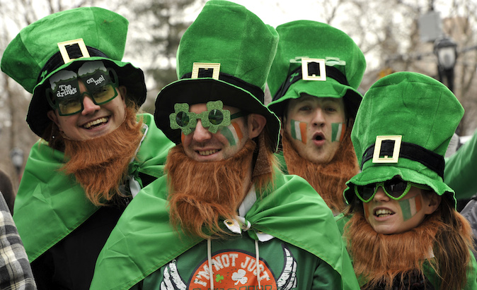 Parade goers  watch as matching bands make their way  up 5th Avenue during the 252th New York City St. Patrick's Day Parade on March 16, 2013. (TIMOTHY A. CLARY/AFP/Getty Images)