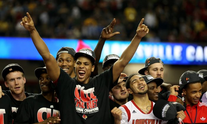 Tim Henderson #15, Russ Smith #2, Wayne Blackshear #20 and Peyton Siva #3 of the Louisville Cardinals celebrate with teammates after they defeated the Michigan Wolverines during the 2013 NCAA Men's Final Four Championship at the Georgia Dome on April 8, 2013 in Atlanta. (Andy Lyons/Getty Images)