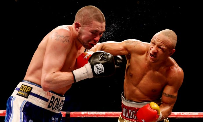 Tony Bellew of England (L) is caught by Isaac Chilemba of Malawi during their WBC Silver Light Heavyweight Championship and World Final Eliminator bout at the O2 Arena on May 25, 2013 in London, England. Bellow lost. (Scott Heavey/Getty Images)