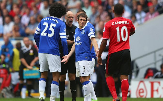 Leighton Baines (C) of Everton looks towards Fraizer Campbell (R) of Cardiff City after an altercation with Marouane Fellaini (L) of Everton during the Barclays Premier League match between Cardiff City and Everton at Cardiff City Stadium on August 31, 2013 in Cardiff, Wales. (Photo by Michael Steele/Getty Images)