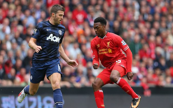Daniel Sturridge of Liverpool competes with Michael Carrick of Manchester United during the Barclays Premier League match between Liverpool and Manchester United at Anfield on September 01, 2013 in Liverpool, England. (Photo by Alex Livesey/Getty Images)