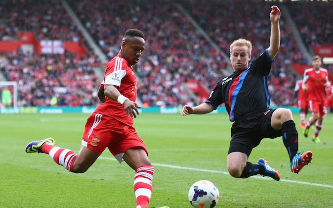 Nathaniel Clyne of Southampton battles for the ball with Dean Moxey of Crystal Palace during the Barclays Premier League match between Southampton and Crystal Palace at St Mary's Stadium on September 28, 2013 in Southampton, England. (Photo by Paul Gilham/Getty Images)