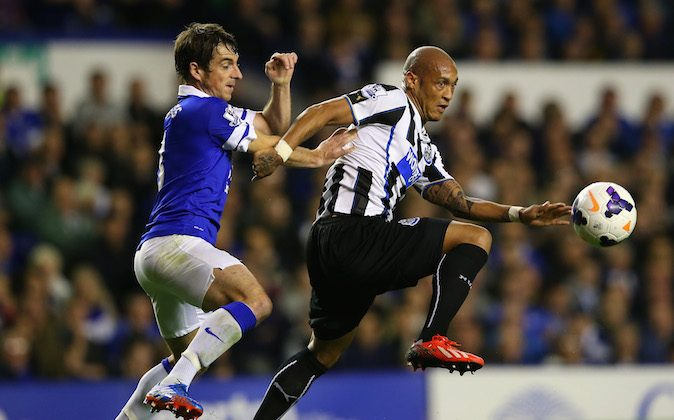 Leighton Baines of Everton battles with Yoan Gouffran of Newcastle during the Barclays Premier League match between Everton and Newcastle United at Goodison Park on September 30, 2013 in Liverpool, England. (Photo by Julian Finney/Getty Images)