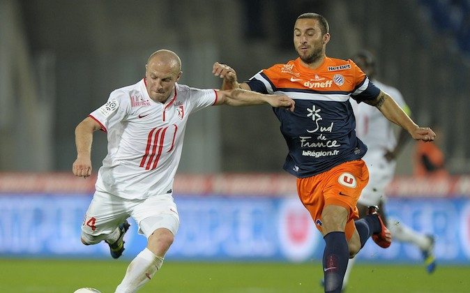 Lille midfielder Florent Balmont (L) fights for the ball with Montpellier's Argentinian forward Emmanuel Herrera (R) on October 19, 2013 during a French L1 football match at the Mosson stadium in the southern French city of Montpellier. (PASCAL GUYOT/AFP/Getty Images)