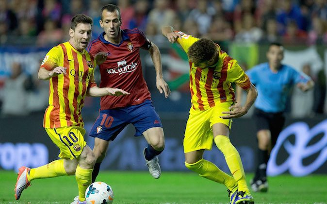 Lionel Messi (L) of FC Barcelona and his teammate Neymar JR. (R) competes for the ball with Patxi Punal (2ndL) of CA Osasuna during the La Liga match between CA Osasuna and FC Barcelona at El Sadar stadium on October 19, 2013 in Pamplona, Spain. (Photo by Gonzalo Arroyo Moreno/Getty Images)