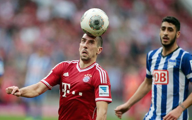 Franck Ribery (L) of Muenchen battles for the ball with Tolga Cigeri of Berlin during the Bundesliga match between FC Bayern Muenchen and Hertha BSC Berlin at Allianz Arena at Allianz Arena on October 26, 2013 in Munich, Germany.  (Photo by Johannes Simon/Bongarts/Getty Images)