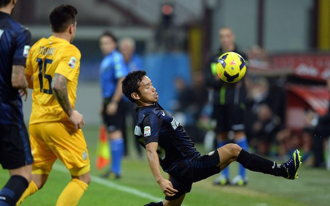 Yuto Nagatomo of FC Inter Milan in action during the Serie A match between FC Internazionale Milano and Hellas Verona at Stadio Giuseppe Meazza on October 26, 2013 in Milan, Italy.  (Photo by Claudio Villa/Getty Images)