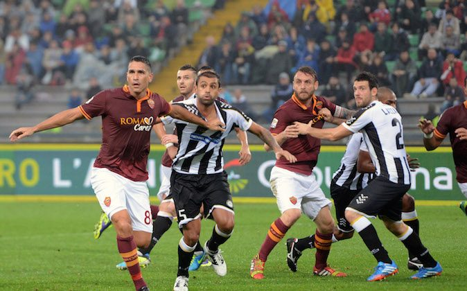 UDINE, ITALY - OCTOBER 27: Danilo Larengeira #5 of Udinese Calcio is challenged to Marco Borriello #8 of AS Roma and Daniele De Rossi (2nd R) of AS Roma is challenged to Andrea Lazzari (1th R) of Udinese calcio during the Serie A match between Udinese Calcio and AS Roma at Stadio Friuli on October 27, 2013 in Udine, Italy.  (Photo by Dino Panato/Getty Images)