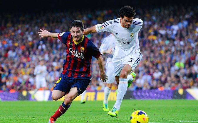 Lionel Messi of FC Barcelona duels for the ball with Pepe of Real Madrid CF during the La Liga match between FC Barcelona and Real Madrid CF at Camp Nou on October 26, 2013 in Barcelona, Spain. (Photo by David Ramos/Getty Images)
