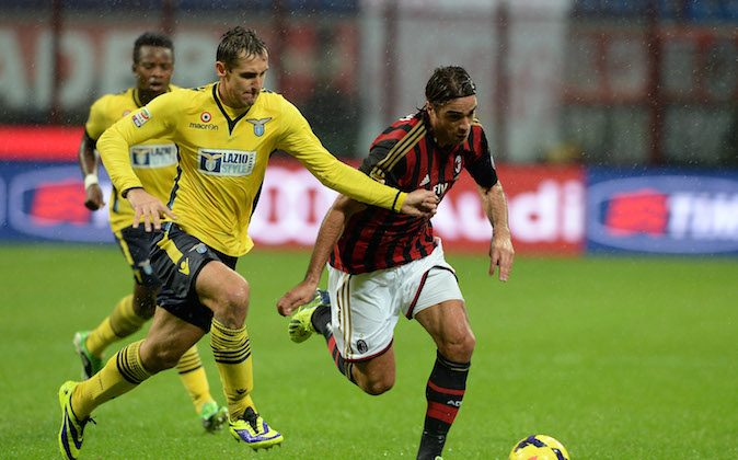 Alessandro Matri of AC Milan and Miroslav Klose of SS Lazio (L) compete for the ball during the Serie A match between AC Milan and SS Lazio at San Siro Stadium on October 30, 2013 in Milan, Italy. (Photo by Claudio Villa/Getty Images)