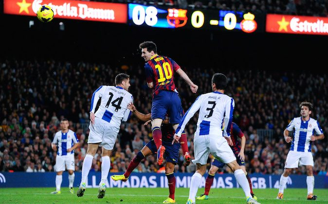 Lionel Messi of FC Barcelona heads the ball towards goal during the La Liga match between FC Barcelona and RCD Espanyol at Camp Nou on November 1, 2013 in Barcelona, Spain. (Photo by David Ramos/Getty Images)