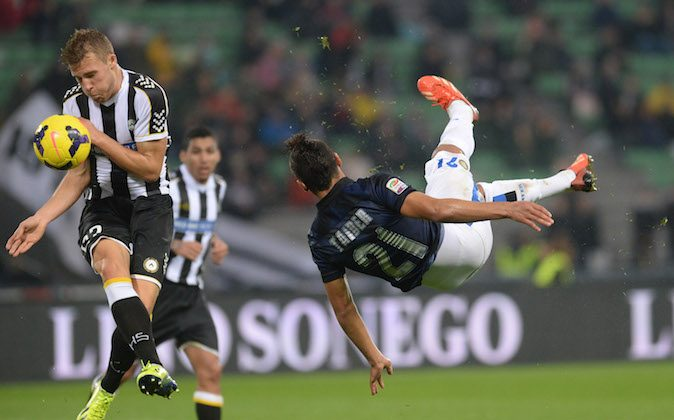 Silvan Widmer (L) of Udinese Calcio competes with Saphir Slitti Taider of FC Internazionale Milano during the Serie A match between Udinese Calcio and FC Internazionale Milano at Stadio Friuli on November 3, 2013 in Udine, Italy.  (Photo by Dino Panato/Getty Images)