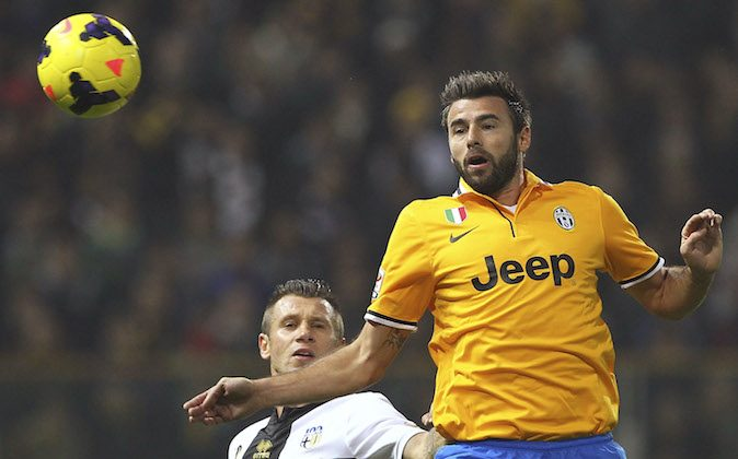 Andrea Barzagli (R) of Juventus competes for the ball with Antonio Cassano (L) of Parma FC during the Serie A match between Parma FC and Juventus at Stadio Ennio Tardini on November 2, 2013 in Parma, Italy. (Photo by Marco Luzzani/Getty Images)