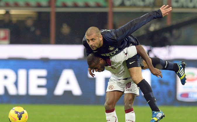 Walter Samuel of FC Inter Milan and Innocent Emeghara of AS Livorno Calcio #20 compete for the ball during the Serie A match between FC Internazionale Milano and AS Livorno Calcio at San Siro Stadium on November 9, 2013 in Milan, Italy. (Photo by Claudio Villa/Getty Images)