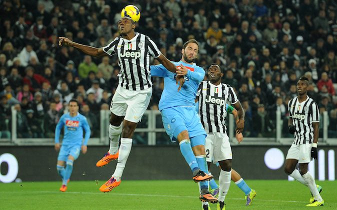 Angelo Ogbonna (L) of Juventus goes up with Gonzalo Higuain of SSC Napoli during the Serie A match between Juventus and SSC Napoli at Juventus Arena on November 10, 2013 in Turin, Italy. (Photo by Valerio Pennicino/Getty Images)