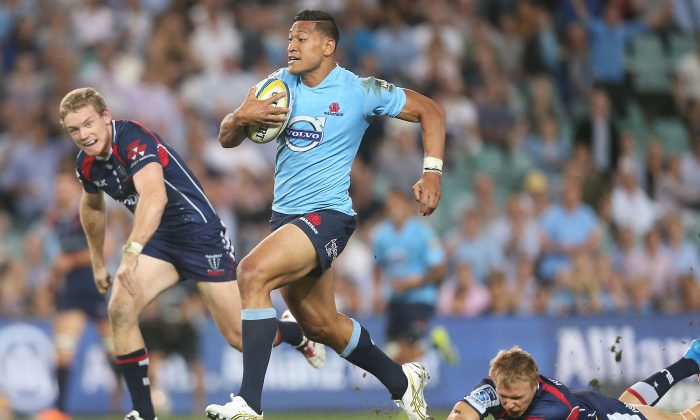 Waratahs full-back Israel Folau breaks the Rebels defence on Saturday March 22, 2014. The Waratahs will miss Folau due to injury in their match against the Sharks on Saturday March 29, 2014 in Durban, South Africa. (Mark Metcalfe/Getty Images)