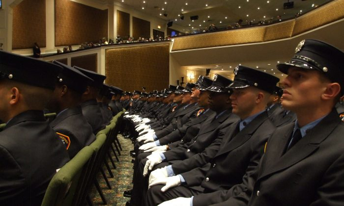 Probationary fire fighters sit during a graduation ceremony at the Christian Cultural Center in New York, Dec. 5, 2013. Their graduating class was the most diverse in Fire Department history with 62 percent minorities. (Holly Kellum)