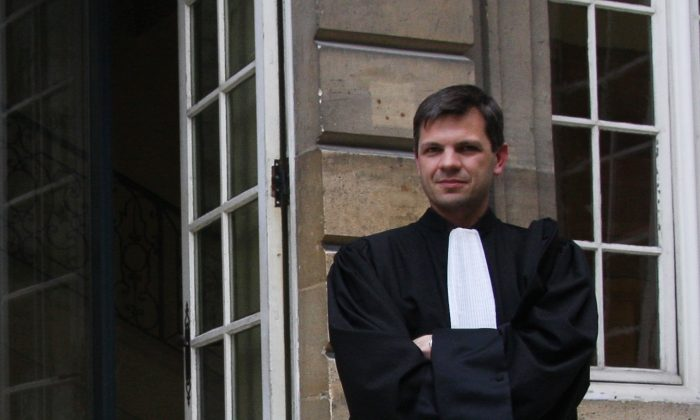 Attorney Gabard, hired by the Falun Gong practitioners to represent them, stands outside of the Paris Administrative Court after the hearing on March 26. (Minghui.org)