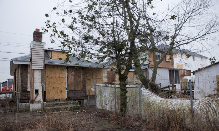 Boarded homes in Oakwood Beach, Staten Island, New York, on Jan. 16, 2014. Communities destroyed by Sandy have received little help from federal recovery programs administered by the city. (Samira Bouaou/Epoch Times)