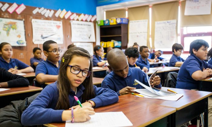 Fifth-grade students during homeroom class at Achievement First Bushwick charter school in Brooklyn, New York, Jan 30, 2014. (Petr Svab/Epoch Times)