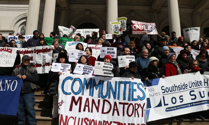 City Council members, Manhattan Borough President Gale Brewer, community groups, and New York City residents rally for mandatory inclusionary housing policies for NYC on the steps of City Hall, March 5, 2014. (Allen Xie)