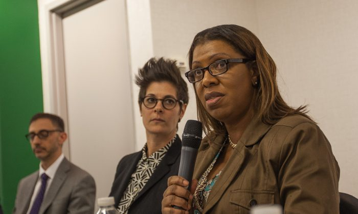 Public Advocate Letitia James offers closing remarks at a town hall meeting in Brooklyn Heights, New York, March 8, 2014. (Petr Svab/Epoch Times)