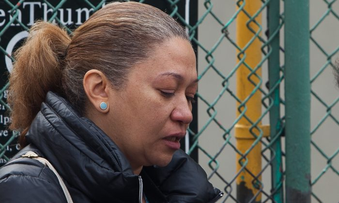 Anna Petances recollects the happenings after a gas explosion leveled her neighboring building, East Harlem, New York, March 12, 2014. (Petr Svab/Epoch Times)