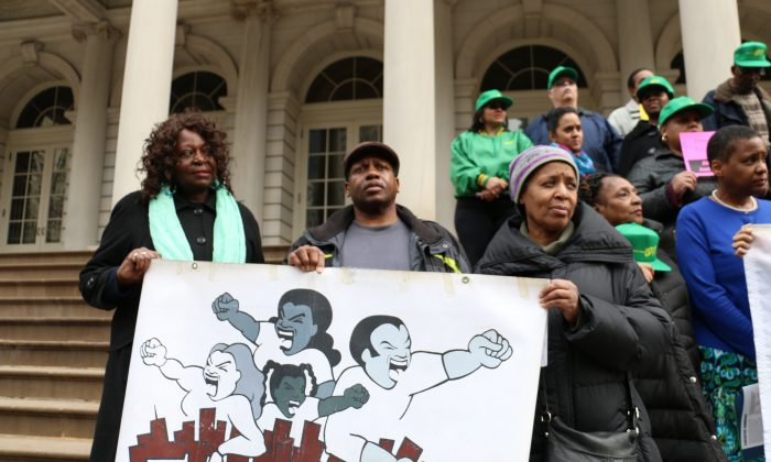 NYCHA residents rally at City Hall steps calling for repairs and long term improvements to city public housing facilities, March 12, 2014. (Bill Xie)