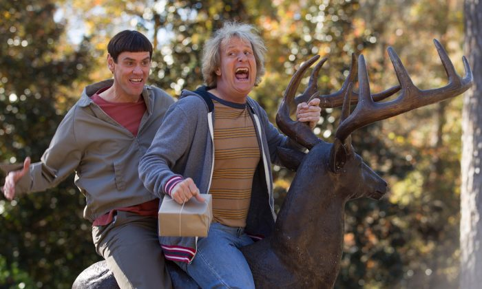 """This image released by Universal Pictures shows Jim Carrey, left, and Jeff Daniels in a scene from the upcoming sequel to """"Dumb and Dumber,"""" called """"Dumb and Dumber To."""" The comedy is scheduled for release on November 14 of this year. (AP Photo/Universal Pictures, Hopper Stone)"""