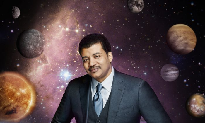 "This photo released by Fox shows Neil deGrasse Tyson, the astrophysicist who hosts the television show, ""Cosmos: A Spacetime Odyssey,"" which premiered Sunday, March 9, 2014 on Fox and simultaneously across multiple U.S. Fox networks. The series explores how we discovered the laws of nature and found our coordinates in space and time.  (AP Photo/Fox, Patrick Eccelsine)"