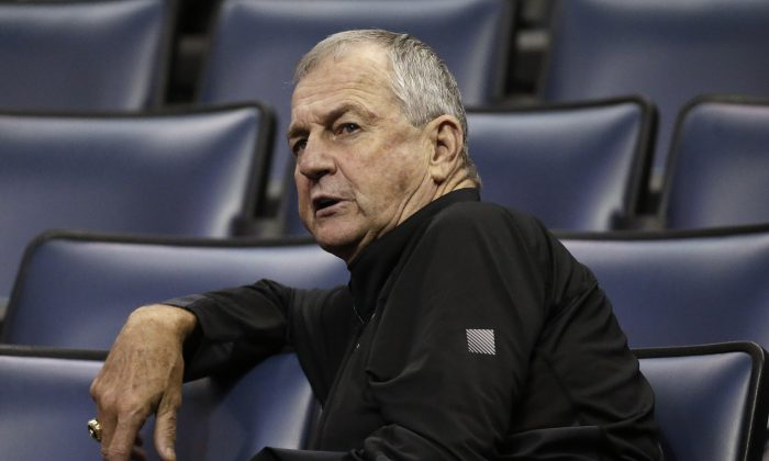 Jim Calhoun, former Connecticut men's basketball coach, watches an NCAA college basketball game between South Florida and Rutgers at the American Athletic Conference tournament Wednesday, March 12, 2014, in Memphis, Tenn. (AP Photo/Mark Humphrey)