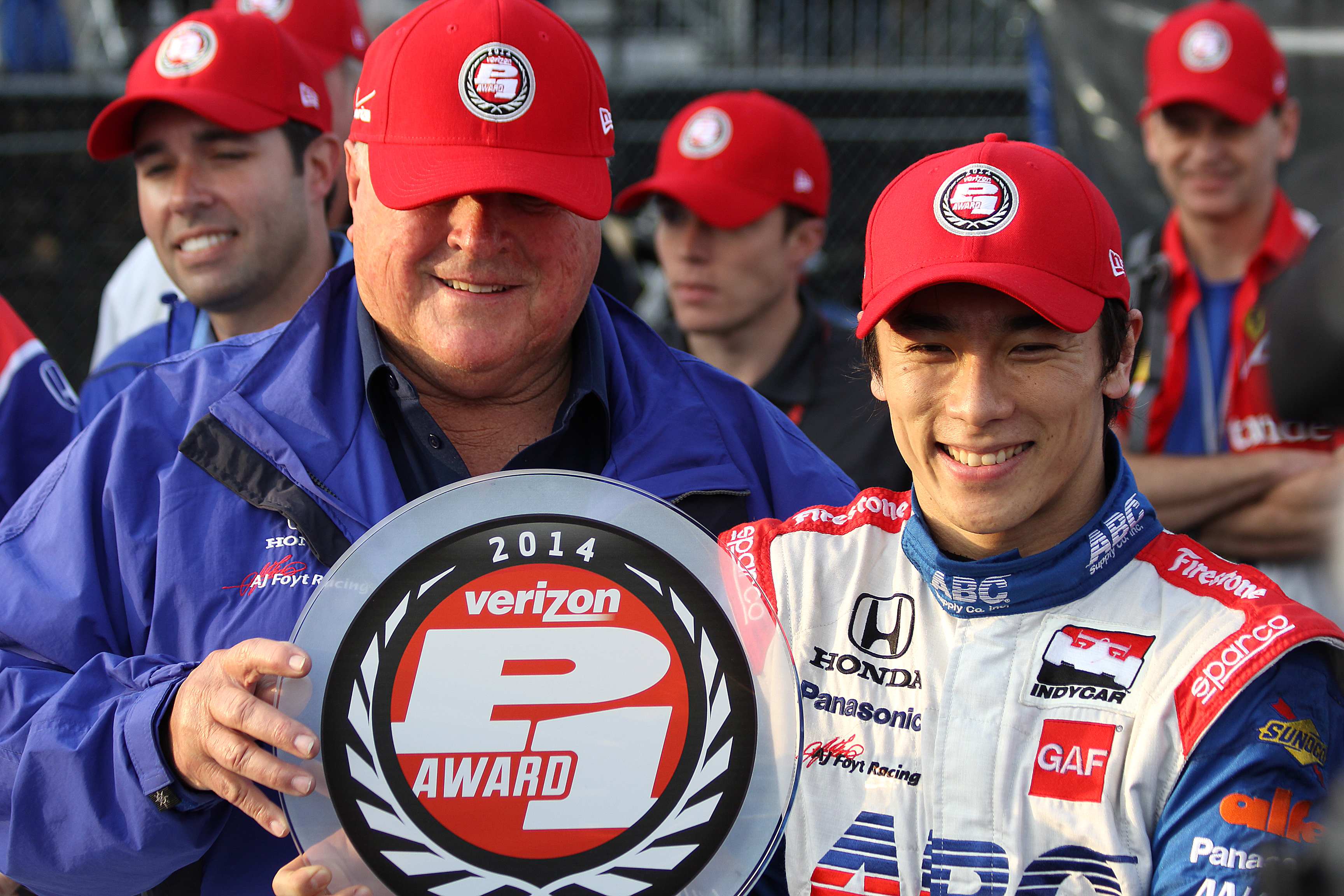 AJ Foyt and Takuma Sato share the Verizon P1 Pole Award after Sato scored the pole for the St. Pete Grand Prix. Saturday, March 29, 2014, in St. Petersburg, Fla. The race starts Sunday afternoon. (Chris Jasurek/Epoch Times)