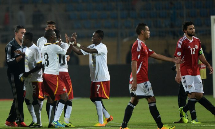 Ghana's players (L) celebrate following their victory over Egypt in their WC2014 African zone qualifier second leg football play-off, at the 30 June Air Defence Stadium in Cairo, on November 19, 2013. (Khaled Desouki/AFP/Getty Images)