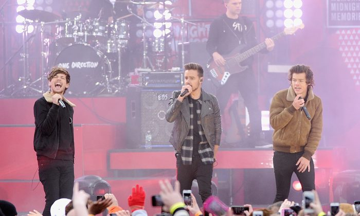 ouis Tomlinson,Liam Payne and Harry Styles and of One Direction perform at Rumsey Playfield on November 26, 2013 in New York City. (amie McCarthy/Getty Images)